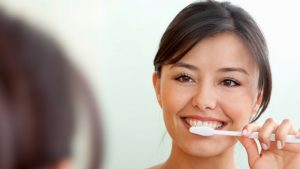 What is dry tooth brushing?